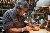 Seventysixyearold Israeli violin maker Amnon Weinstein restores a violin which he named the 'Auschwitz Violin' since it belonged to a Jewish man...