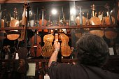 Seventysixyearold Israeli violin maker Amnon Weinstein shows his violin collection of old violins that were formerly owned by European Jews during...