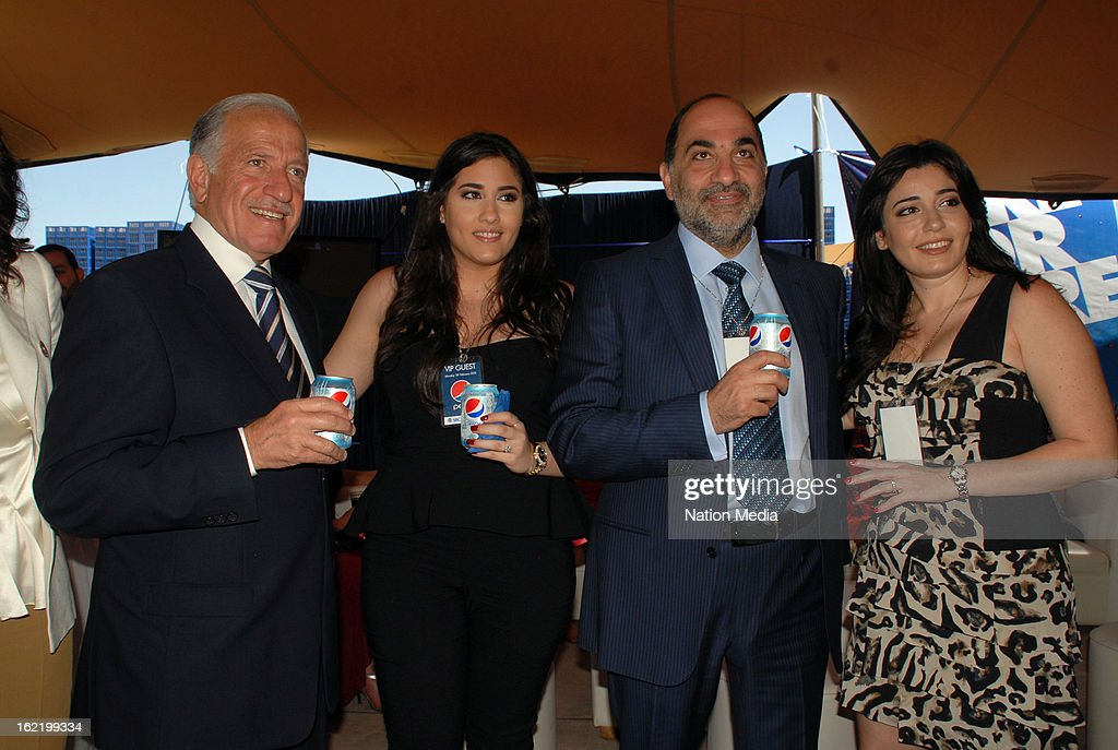 Seven-Up Bottling Company Kenya's Chairman Faysal El-Khalil with his family; Lana El-Khalil, Zaid El-Khalil and Zeina El-Khalil at the launch of the Pepsi Cola manufacturing plant on February 18, 2013 in Nairobi, Kenya. Faysal El-Khalil said the new manufacturing plant has been established to improve Kenya's market growth. The plant is equipped with advanced technologies to promote operating efficiencies while reducing water and energy use.