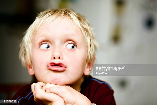 Seven-year-old boy rolls his eyes to the right