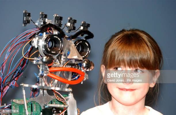 Sevenyearold Georgia Anderson of Market Harborough Leicestershire with 'eMo' the robot The robot which goes on show at the 'Thinktank' at...