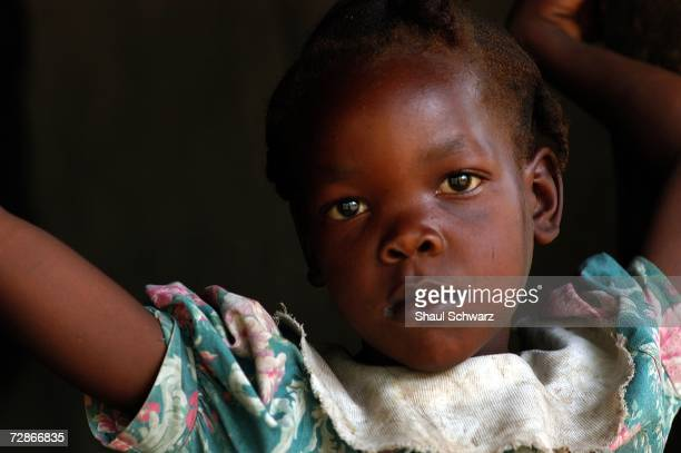 Sevenyearold Meloude Casseus a former 'restavek' poses at her family's home on April 11 2005 in a rural village near Les Cayes Haiti Meloude was...