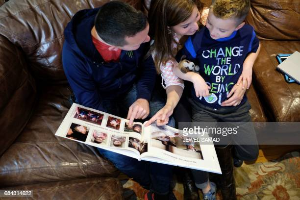 Sevenyearold transgender boy Jacob Lemay and his parents Joe and Mimi look at their family photo before his transition at their home in Melrose...