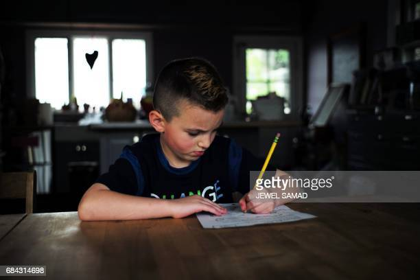 Sevenyearold transgender boy Jacob Lemay does his homework at his home in Melrose Massachusetts on May 9 2017 For months in the Lemay home the same...