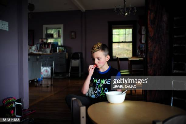 Sevenyearold transgender boy Jacob Lemay eats lunch in his house in Melrose Massachusetts on May 9 2017 For months in the Lemay home the same phrase...