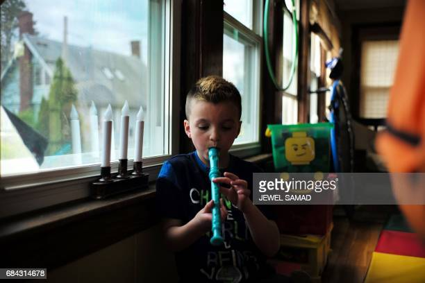 Sevenyearold transgender boy Jacob Lemay plays a recorder in his house in Melrose Massachusetts on May 9 2017 For months in the Lemay home the same...