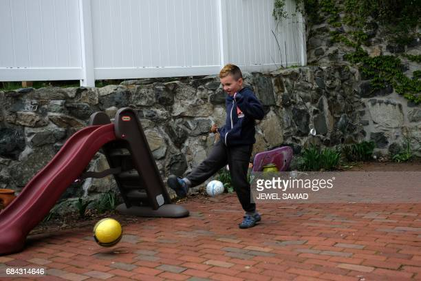 Sevenyearold transgender boy Jacob Lemay plays in the yard of his home in Melrose Massachusetts on May 9 2017 For months in the Lemay home the same...