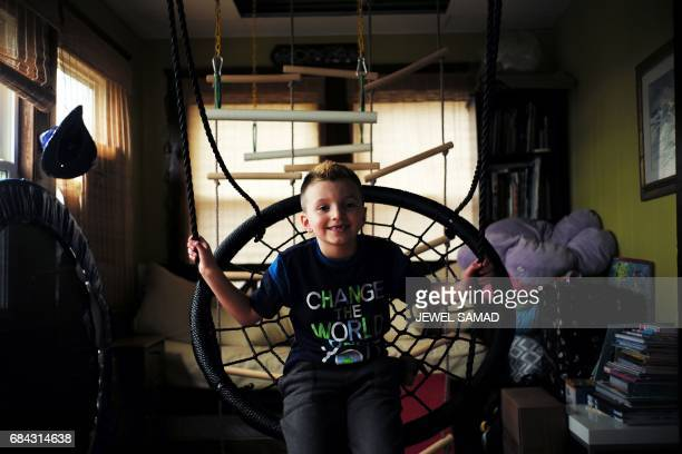 Sevenyearold transgender boy Jacob Lemay poses for photos in his house in Melrose Massachusetts on May 9 2017 For months in the Lemay home the same...