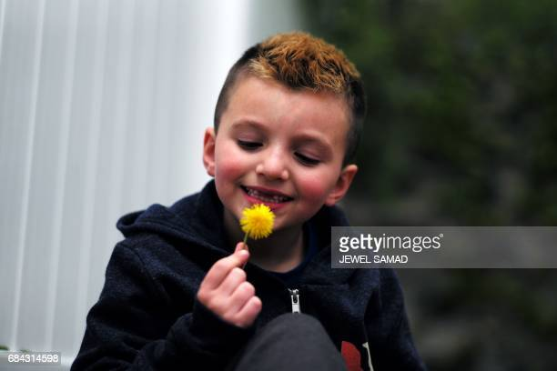 Sevenyearold transgender boy Jacob Lemay poses for photos in the yard of his home in Melrose Massachusetts on May 9 2017 For months in the Lemay home...