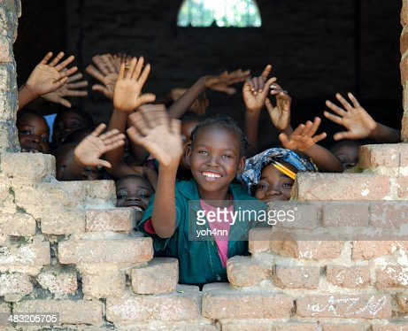 Several African children waving hands in Tchad