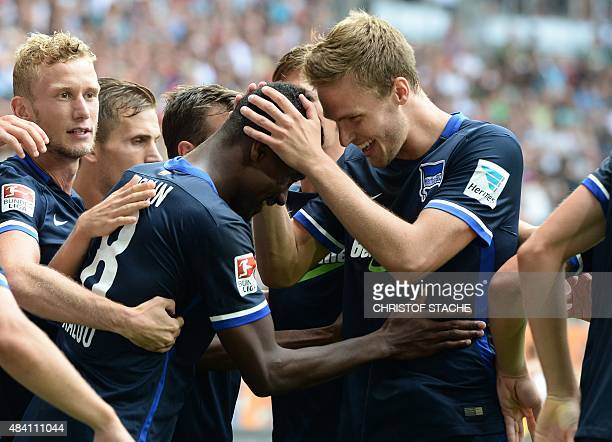 Several Berlin players celebrate with Berlin's striker Salomon Kalou from Ivory Coast after scoring the penalty during the German first division...