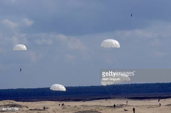 Several 'Blue Berets' paratroopers land after jumping from an Antonov2 aircraft The group is practicing 1200meter and 800meter jumps during training...