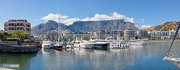 Several boats docked in a waterfront in Cape Town