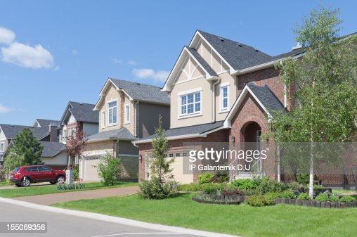Several brand new suburban houses in sunny summer afternoon. Hou