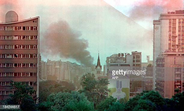 Several buildings burn in Sarajevo after continued shelling of the city by Serbian forces 24 August 1992 More than 30 civilians have been killed and...