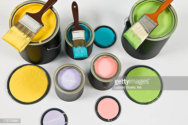 Several cans of colorful house paint
