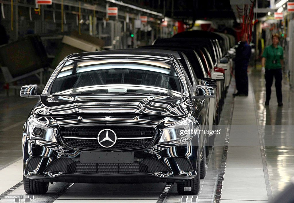 Several CLA type Mercedes cars stand on the production line of the new factory of German car maker Daimler AG Mercedes Benz in Kecskemet, Hungary on January 25, 2013. German luxury car maker Daimler has completed construction of an 800 million Euro factory in Kecskemet. The project is the largest new investment by far in recent years in Hungary and one which highlights the government's ambivalent relationship to investors.