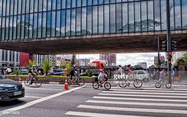 Several cyclists of different age in front of the MASP Museum of Art of São Paulo in Paulista Avenue All sundays one track of avenue is exclusive for...