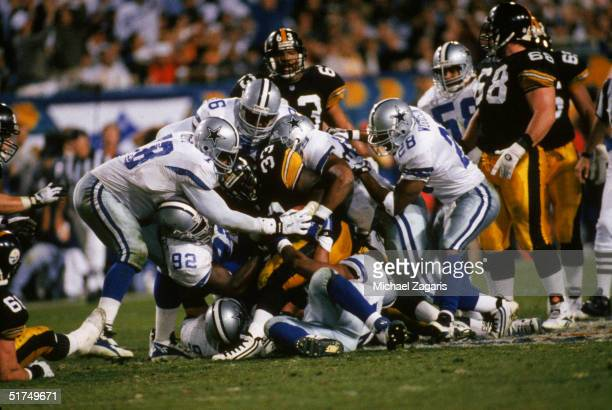 Several Dallas Cowboys players including defensive end Tony Tolbert defensive tackle Leon Lett and safety Darren Woodson combine to stop Pittsburgh...