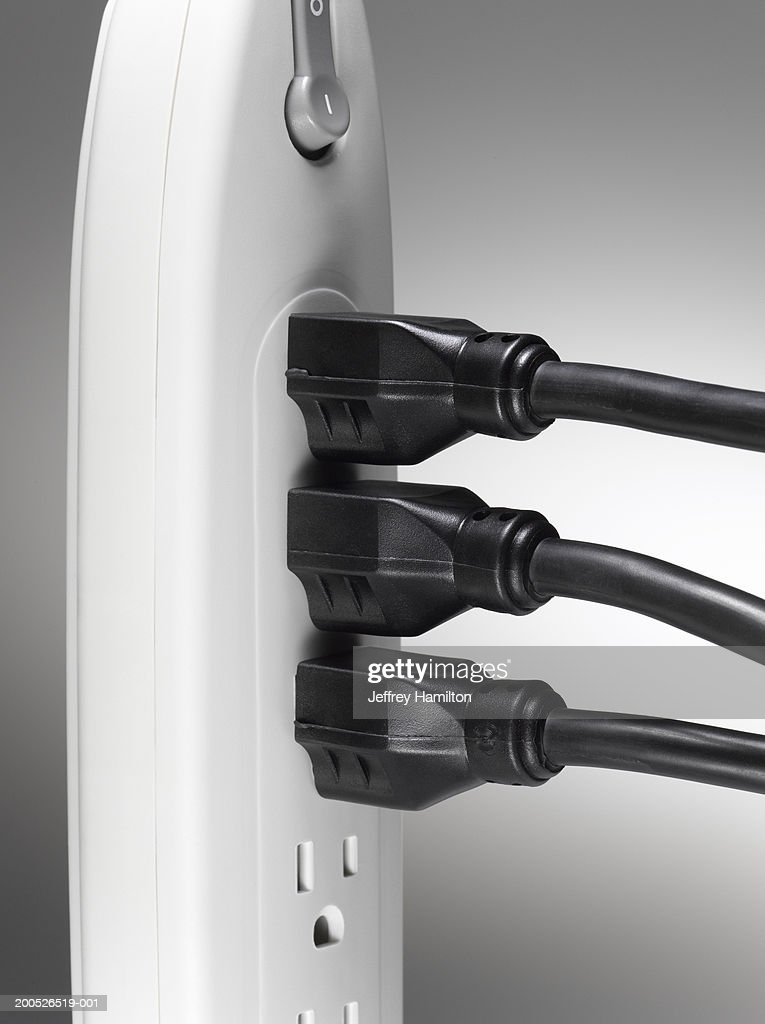 Plugs Into An Extension Cord : Several extension cords plugged into socket