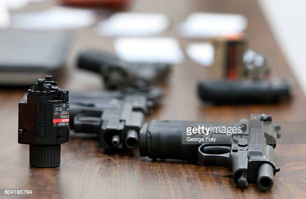 Several guns lay on a table during a class to obtain the Utah concealed gun carry permit at Range Master of Utah on January 9 2016 in Springville...