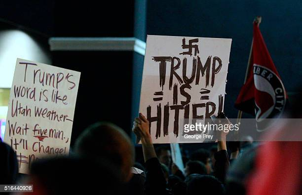 Several hundred antiTrump protesters gather outside the Infinity Event Center where Republican presidential candidate Donald Trump was to speak at a...