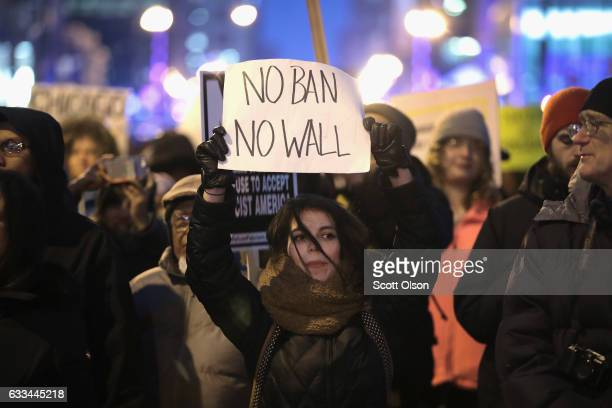 Several hundred demonstrators protest President Donald Trump's executive order which imposes a freeze on admitting refugees into the United States...