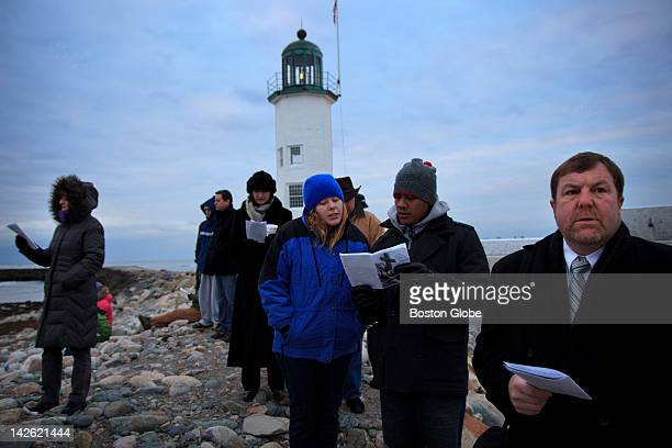 Several hundred people gathered at the lighthouse in Scituate Harbor at dawn for an Easter morning service led by pastor Dan Eddy of Christ Lutheran...