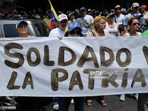 Several hundreds of Venezuelans marched Sunday in Caracas against 'Cuban interference' March 16 2014 as the protests against Venezuelan President...