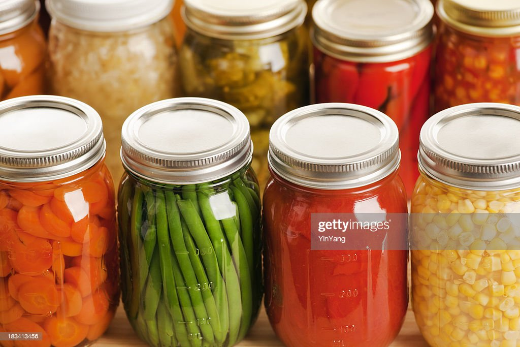 Several jars of harvest vegetables in rows : Stock Photo