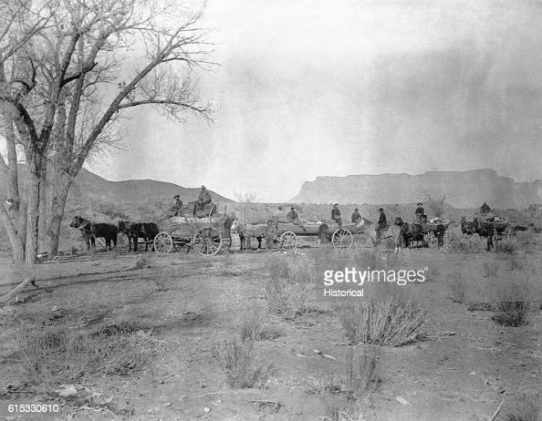 Several members of the Stanton Survey in wagons drawn by horses Colorado River Valley ca 18891890 | Location Colorado River Valley USA