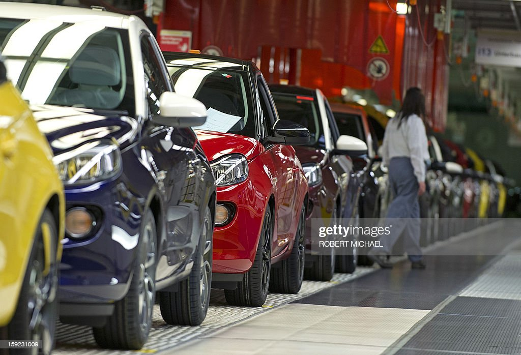 Several models in various colours of the new Opel Adam car stand on the production line during the opening ceremony at the Opel plant in Eisenach, eastern Germany on January 10, 2013. The new Opel model will be produced as of January 10, 2013 at the Eisenach Opel plant and is intended to attract young automobile drivers in cities. Opel has already received 16 000 orders for the Adam.