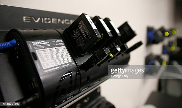 Several newlydeployed body cameras and batteries sit in the patrol room charging and downloading video at the West Valley City Police Department on...