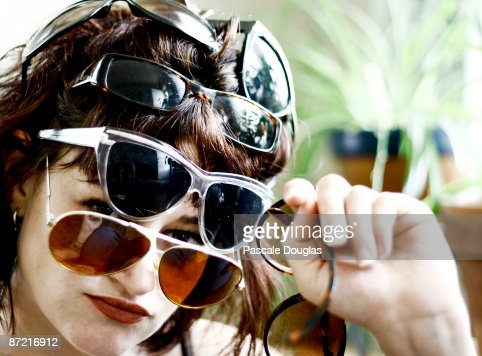 Several Pairs of Sunglasses on One Head