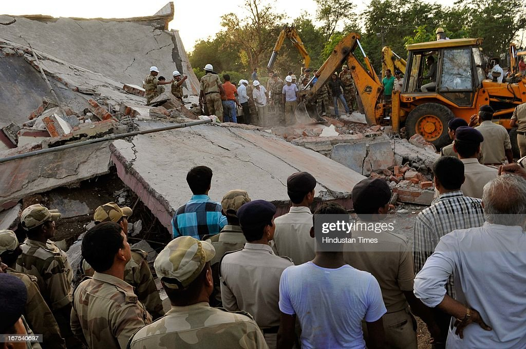 Several people are feared trapped in debris when an under construction wing of Kasturba Gandhi hospital collapsed on April 26, 2013 in Bhopal, India. The collapse feared killed at least five persons while about 40 others were trapped in debris, giving rise to fear of more casualties. The rescue work was being carried out on war footing. Kasturba hospital, one of the biggest and oldest hospitals in Bhopal city, provides free treatment to BHEL employees.