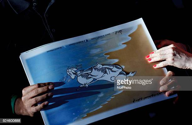 Several people holding a drawing of Aylan during the Demonstration in support to World refugee day in Madrid on September 12 2015