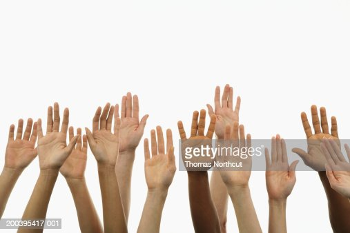 Several people holding their hands in the air : Photo