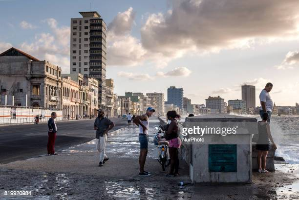 Several people walk the Malecón in Havana on 31 May 2017