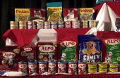 Several pet food items that the Nestle Company make are displayed during a press conference to announce that Nestle and Ralston Purina will merge...