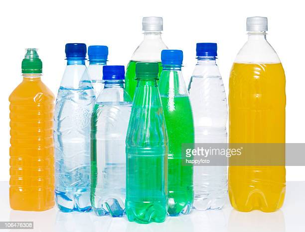 Several plastic bottles filled with various drinks