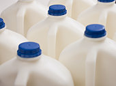 Several plastic containers of milk