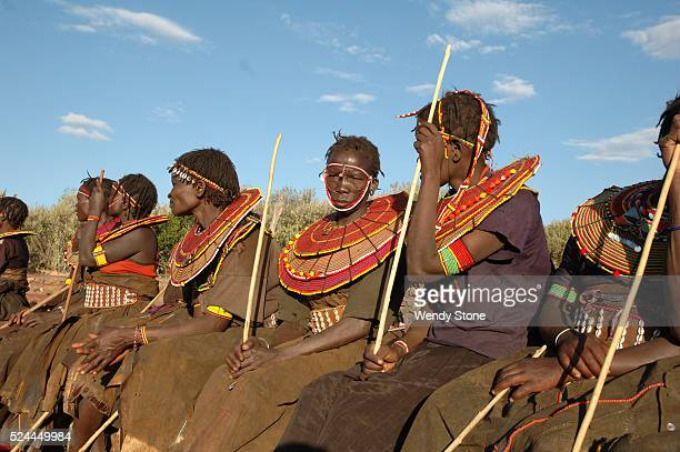 Several Pokot women wearing their traditional dress sit at the Earth Festivalat the Laikipia Nature Conservancy The Pokot a small Nilotic tribe live...