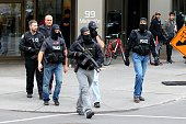 Several police officers walk near downtown Ottawa on October 22 2014 Gunfire echoed through the Gothic halls of the Canadian parliament Wednesday as...