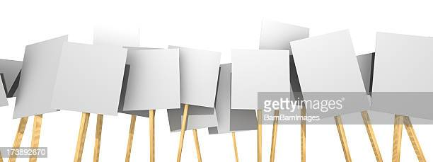 Several protest picket signs with nothing on them