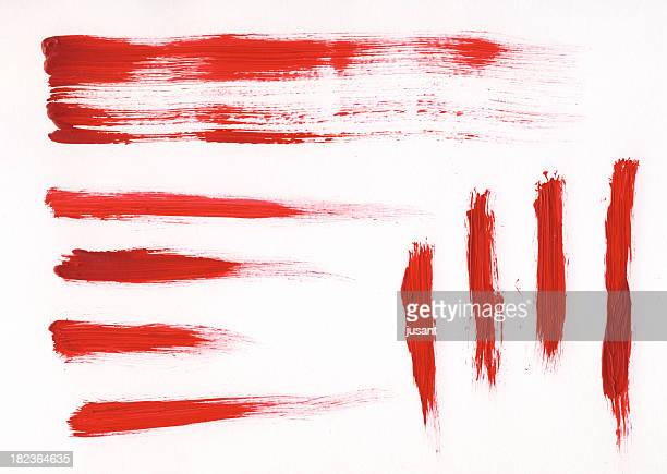 Several red brush strokes of various lengths