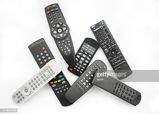 Several remote controls against white background