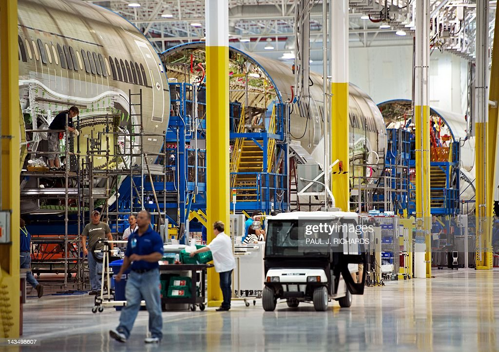 Several sections of Dreamliner 787 fuselage are seen during production at Boeing's new facilities April 27, 2012, in North Charlston, South Carolina. Boeing rolled-off it's first South Carolina made 787 Dreamliner aircraft here today. AFP PHOTO/Paul J. Richards / AFP / PAUL
