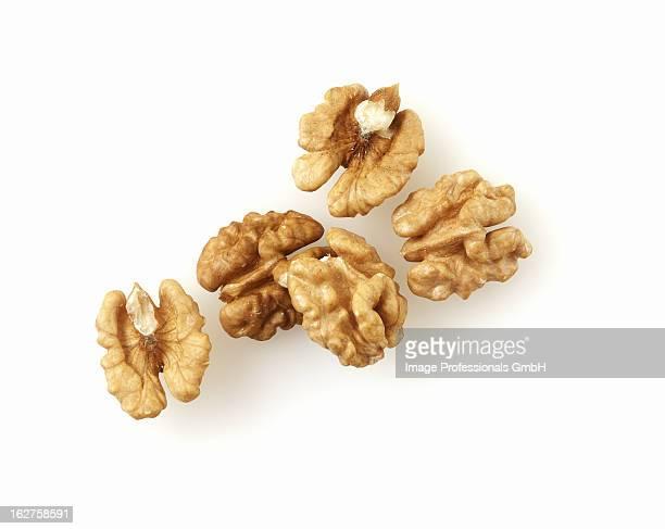 Several shelled walnuts