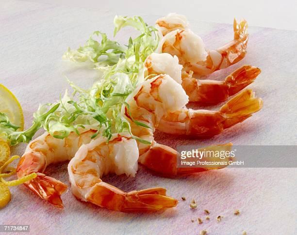 Several shrimp tails and fris?e