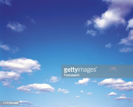Several Small Clouds Floating in the Light Blue Sky, Low Angle View